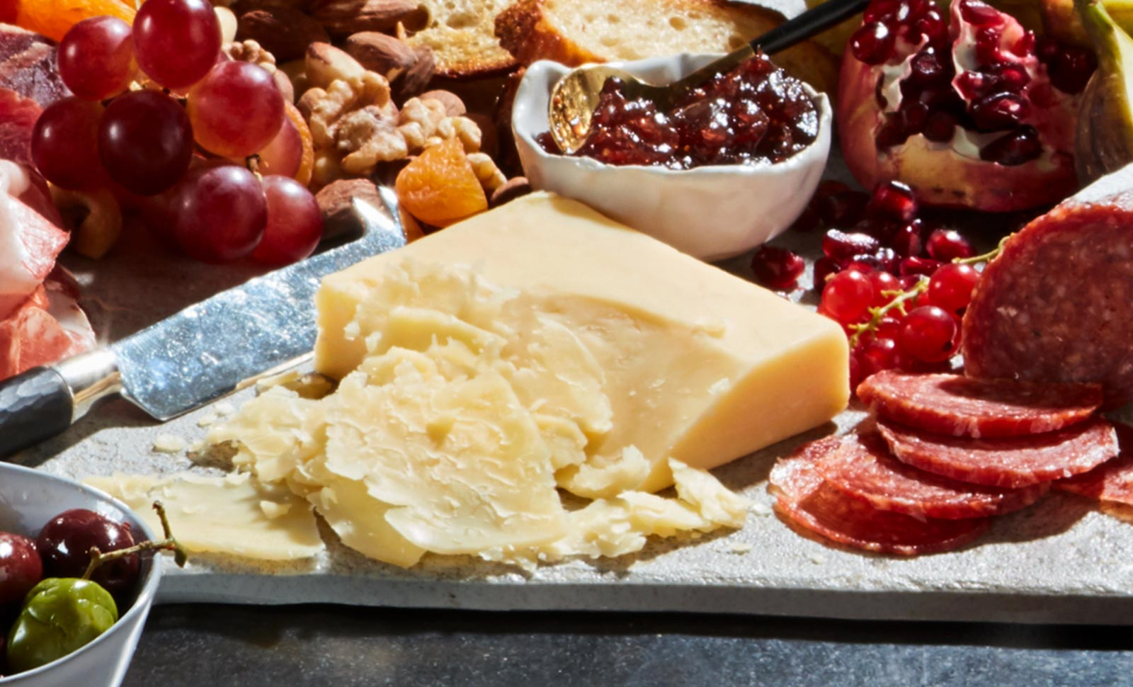 5 year aged cheddar with an assortment of fruits, nuts and sliced meats.
