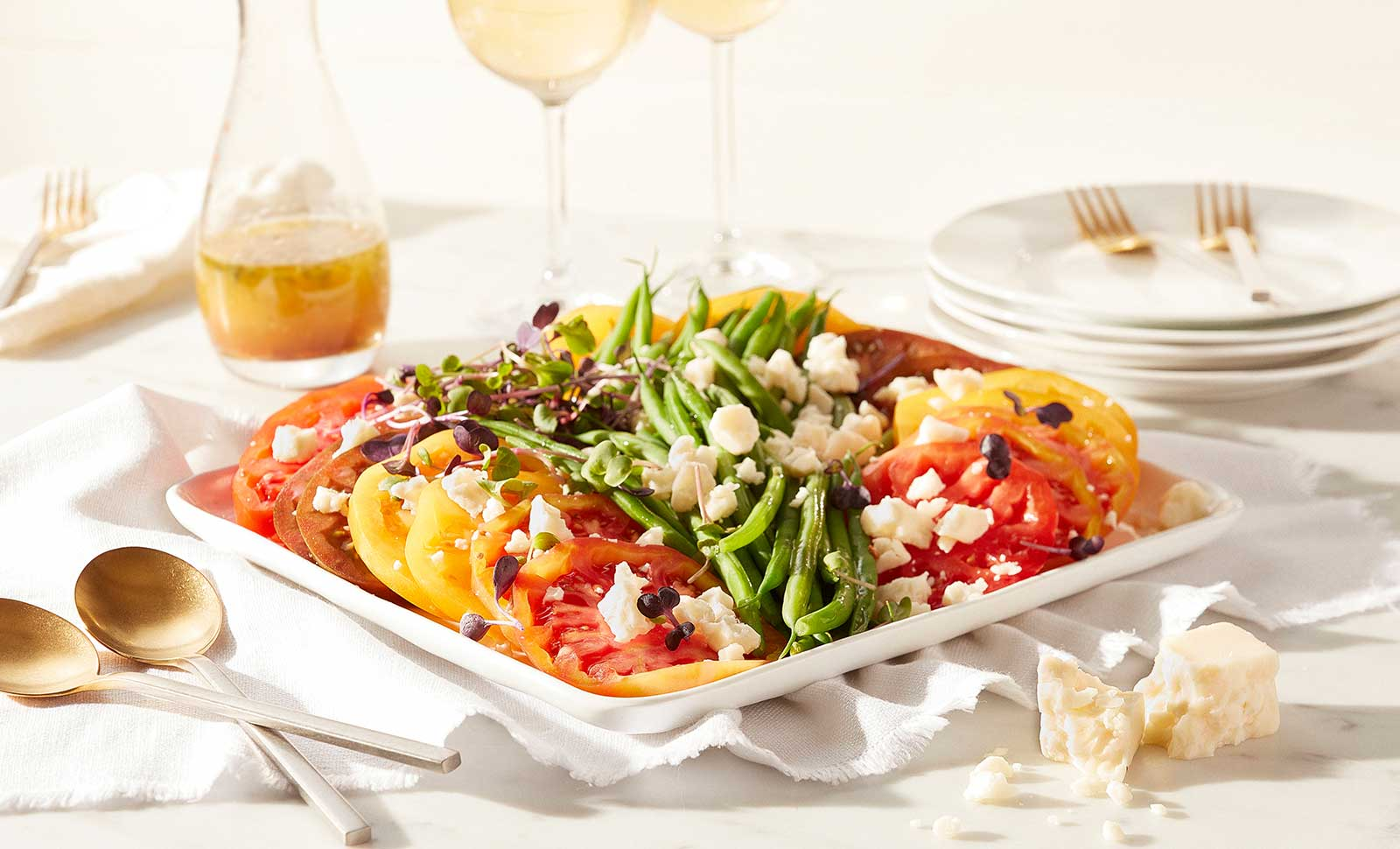 A plate of heirloom tomato and green bean salad.