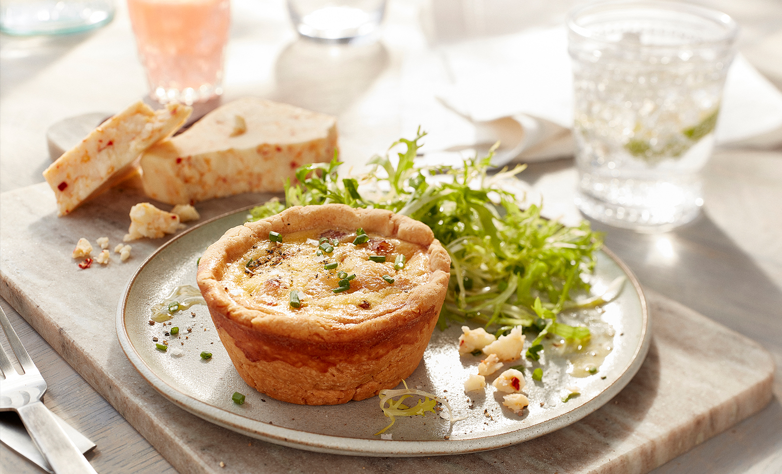 Mini ham cheese quiche served with a small garden salad with Monterey pepper jack cheese on the side.